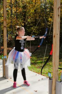 In typical Zoe style, you can't shoot a bow without a tutu.